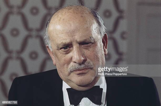 English film producer Michael Balcon pictured wearing a black bow tie at an arts function in London in November 1970