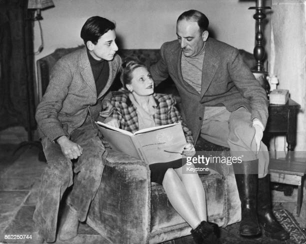 English film producer Michael Balcon with his wife Aileen and their son Jonathan at their home at Forest Row England 31st December 1948 Balcon had...