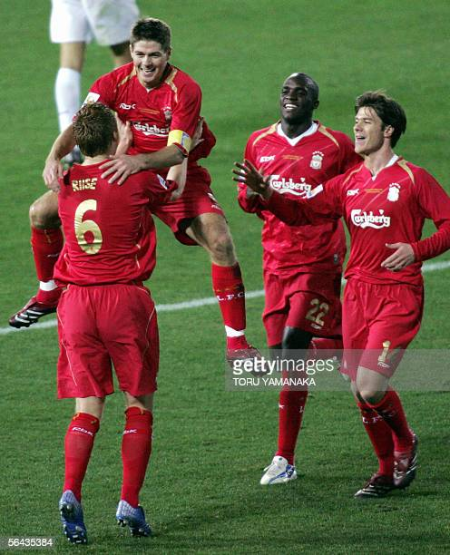 English football club Liverpool's captian Steven Gerrard celebrates with teammate John Arne Riise his goal against Costa Rican club Deportivo...