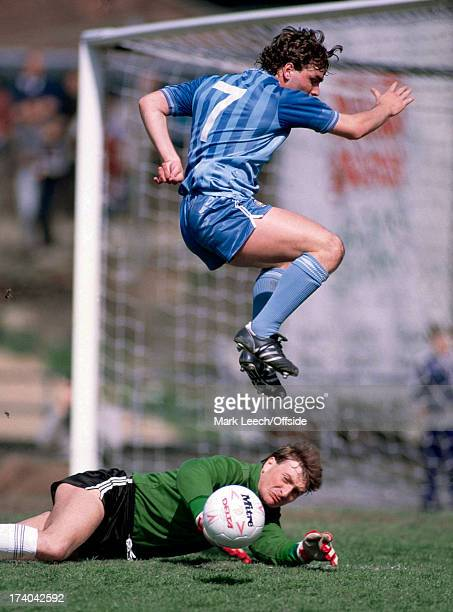 English Football League Division One Notts County v Manchester City County goalkeeper Mick Leonard saves from the leaping Paul Simpson