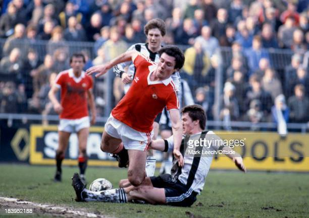 English Football League Division One Notts County v Manchester United Ray O'Brien slides in and tackles Frank Stapleton