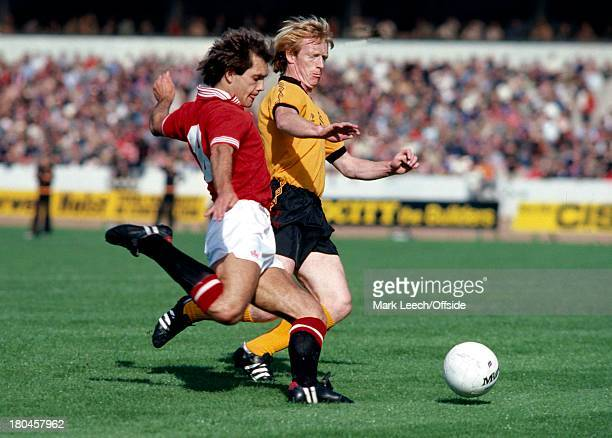 English Football League Division OneWolverhampton Wanderers v Manchester UnitedRay Wilkins comes under pressure from Willie Carr