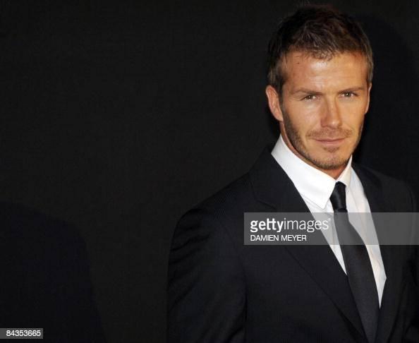 English football player David Beckham poses prior the Emporio Armani FallWinter 20092010 Menswear fashion show on January 18 2009 during the Men's...