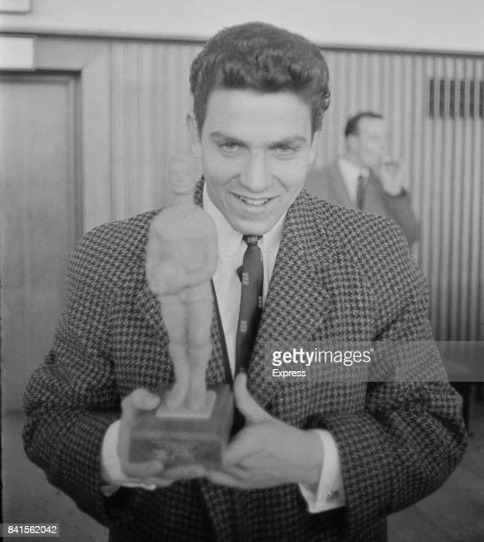 English football player Don Rogers holds 'Best Player' trophy won during the Junior World Cup competition Heathrow Airport UK 9th April 1964