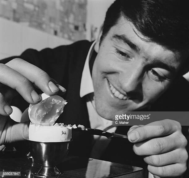 English football player for Tottenham Hotspur FC Terry Venables enjoying a hard boiled egg 27th January 1967