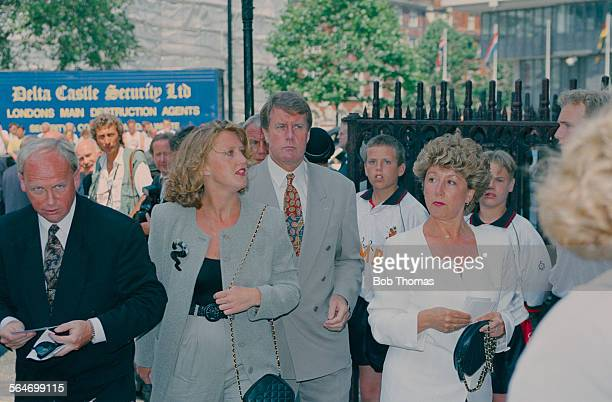 English football player Geoff Hurst with his wife Judith at a memorial service for English footballer Bobby Moore at Westminster Abbey London 28th...