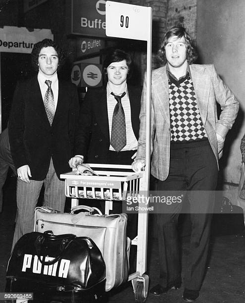 English football players John McDowell Steve Perryman and Tommy Taylor pictured with their suitcases as they travel for a match against Scotland at...