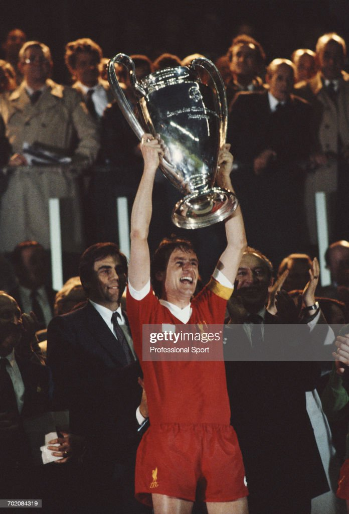 English footballer and captain of Liverpool FC, Phil Thompson lifts up the European Cup trophy in celebration after Liverpool beat Real Madrid 1-0 in the European Cup Final to become champions at Parc des Princes in Paris, France on 27th May 1981.