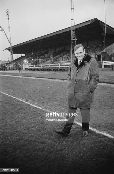 English footballer and manager Don Revie examines the pitch at the Borough Sports Ground on the eve of the Leeds United FC v Sutton United FC FA...