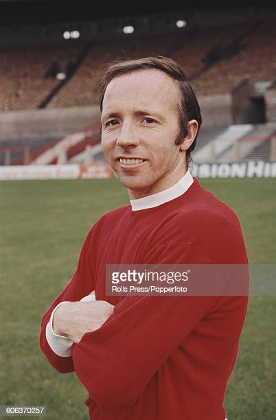 English footballer and midfielder with Manchester United Football Club Nobby Stiles posed on the pitch at United's Old Trafford stadium in Manchester...