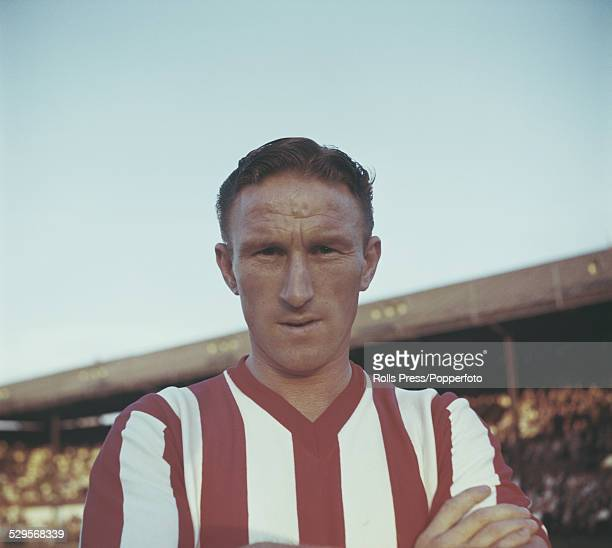 English footballer and striker with Brentford FC Jim Towers pictured standing on the pitch at Griffin Park in Brentford circa 1960