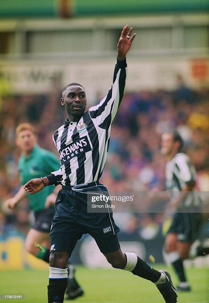 English footballer <a gi-track='captionPersonalityLinkClicked' href=/galleries/search?phrase=Andrew+Cole+-+Soccer+Player&family=editorial&specificpeople=220249 ng-click='$event.stopPropagation()'>Andrew Cole</a> of Newcastle United, celebrates his goal against Aston Villa during an English Premier League match at Villa Park, Birmingham, 2nd October 1993. United won the match 2-0.