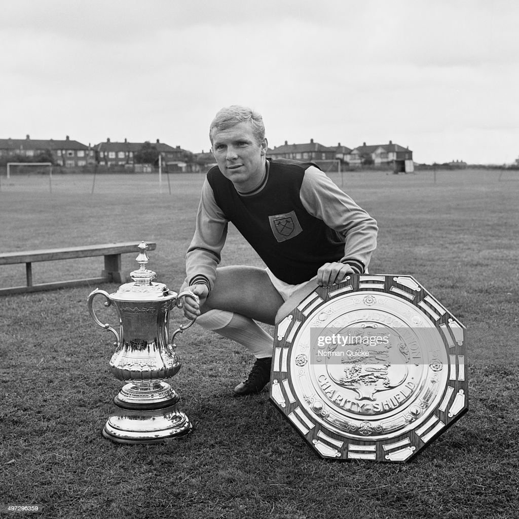 English footballer Bobby Moore of West Ham United FC with the FA Cup and the FA Charity Shield UK 18th August 1964