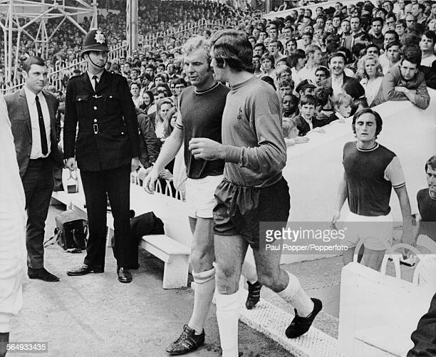 English footballer Bobby Moore walks onto the pitch before a match against Tottenham Hotspur at White Hart Lane London 15th August 1970 He is watched...