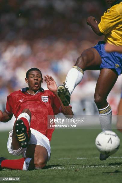 English footballer Carlton Palmer slides in to tackle a Brazil player for the ball in the international friendly match between England and Brazil at...