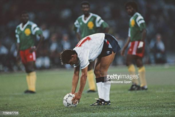 English footballer Gary Lineker places the ball on the spot as he prepares to take a penalty in the quarter final match between Cameroon and England...