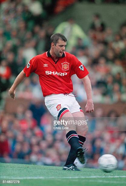 English footballer Gary Pallister playing for Manchester United against Wimbledon FC in an English Premier League match at Old Trafford Manchester...