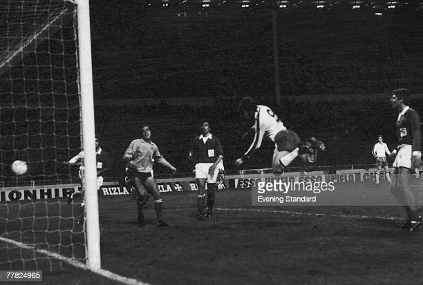 English footballer Malcolm Macdonald scores his fifth goal of the match with a header in the 87th minute during a European Championship Qualifier...