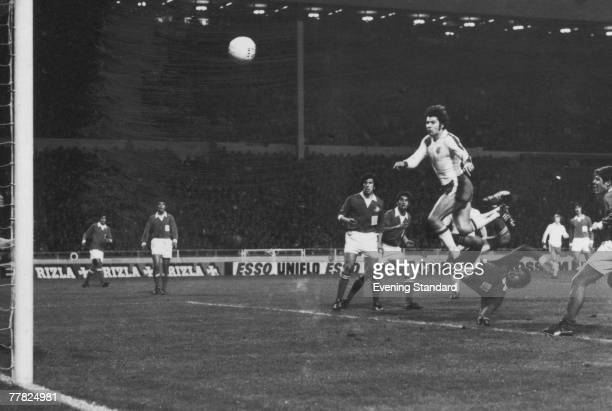 English footballer Malcolm Macdonald scores his fourth goal of the match with a header in the 56th minute during a European Championship Qualifier...