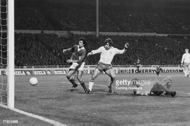 English footballer Malcolm Macdonald scores his third goal of the match in the 87th minute during a European Championship Qualifier between England...