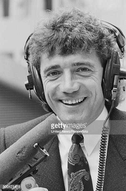 English footballer manager and broadcaster Kevin Keegan posed wearing commentator's headset on 15th October 1985