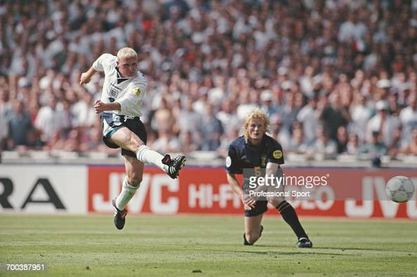 English footballer Paul Gascoigne scores England's second goal as Colin Hendry of Scotland looks on during the England v Scotland match in Group A of...