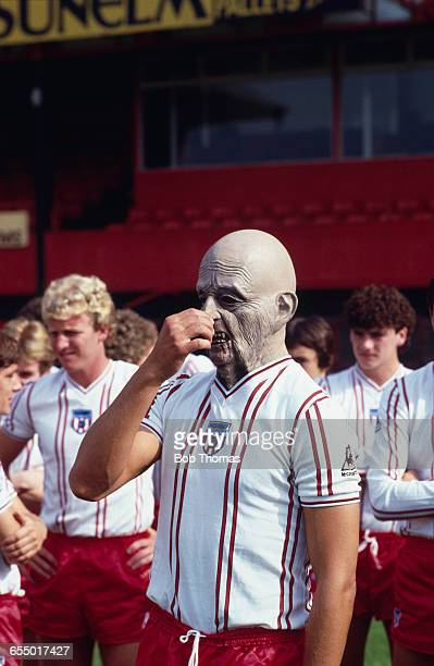 English footballer Sam Allardyce of Sunderland AFC wearing a horror mask at a team photocall 1981