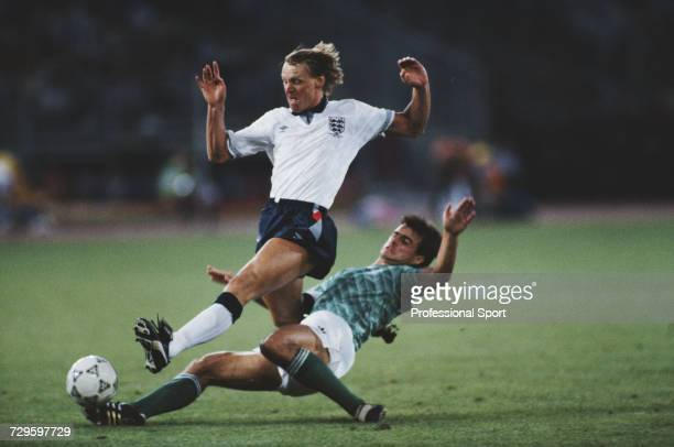 English footballer Stuart Pearce is tackled by West Germany player Thomas Berthold during the semi final match between West Germany and England in...