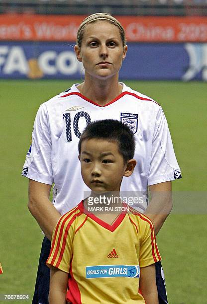 English forward Kelly Smith poses for a group photo with a young Chinese boy before the England and Japan game at the 2007 FIFA Women's World Cup...