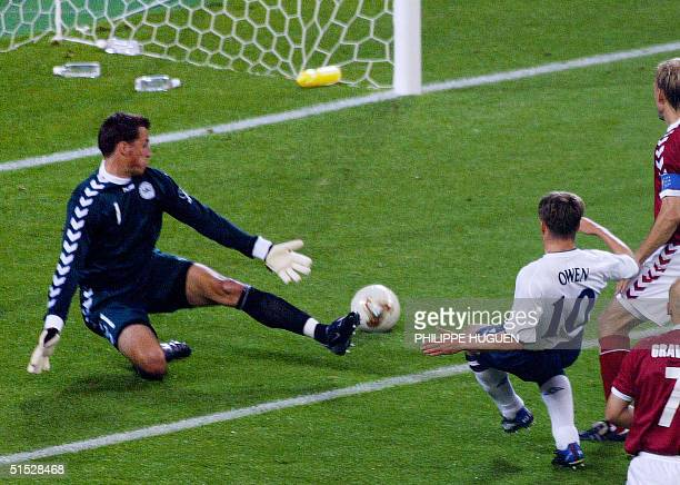 English forward Michael Owen shoots the ball to score his team's second goal despite Danish goalkeeper Thomas Sorensen during the second round match...