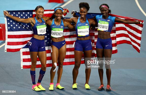English Gardner Allyson Felix Tianna Bartoletta and Tori Bowie of the United States celebrate winning gold in the Women's 4 x 100m Relay Final on Day...
