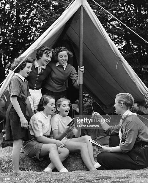 English Girl Guides are taught the Swedish song 'Dar Gingo Tre Jantor I Solen' by a Swedish student teacher at the Hertfordshire County Council...