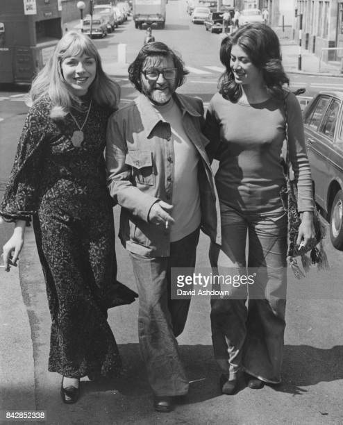 English glamour photographer and erotic film director George Harrison Marks and his wife Toni arrive at Clerkenwell Court in London on obscenity...