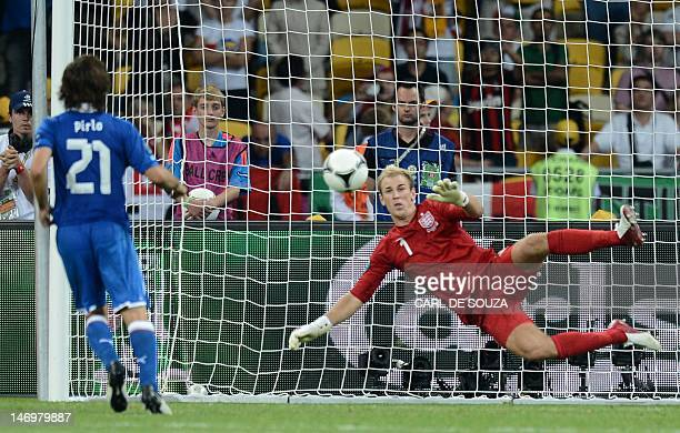 English goalkeeper Joe Hart dives as Italian midfielder Andrea Pirlo scores from the penalty spot during the penalty shoot out at the end of the Euro...