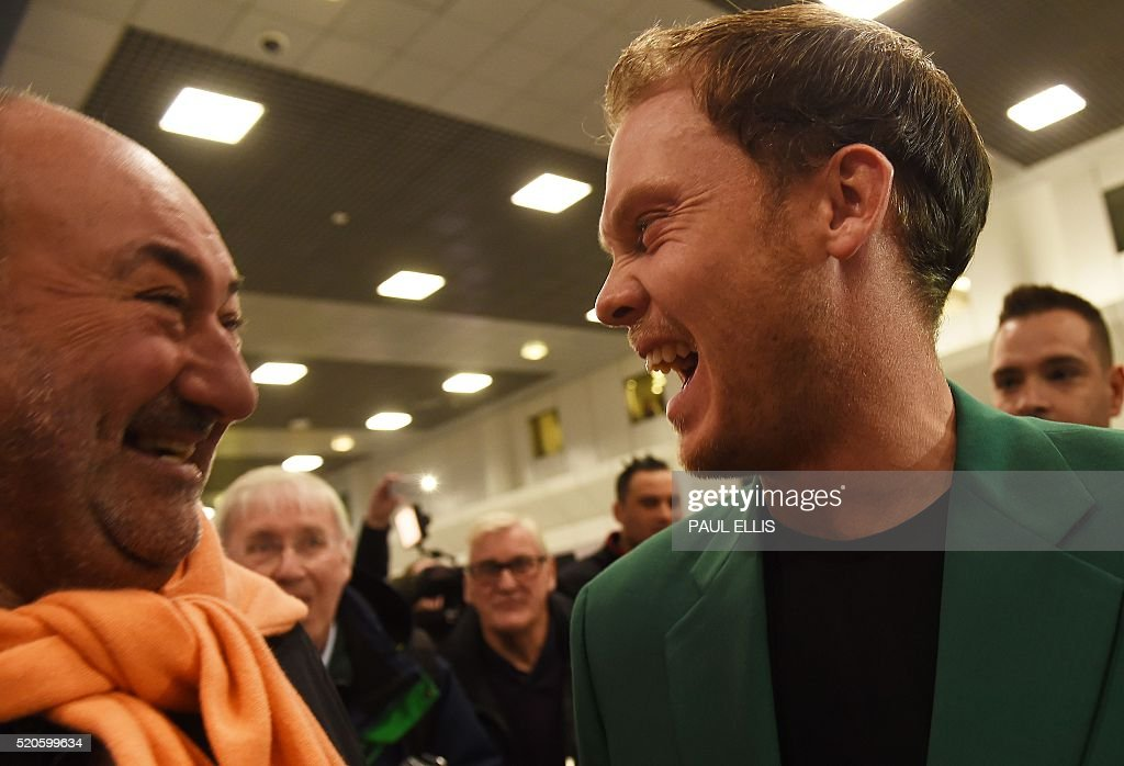 English golfer Danny Willett laughs with Managing Director of International Sports Management and retired English golfer Andrew 'Chubby' Chandler at...