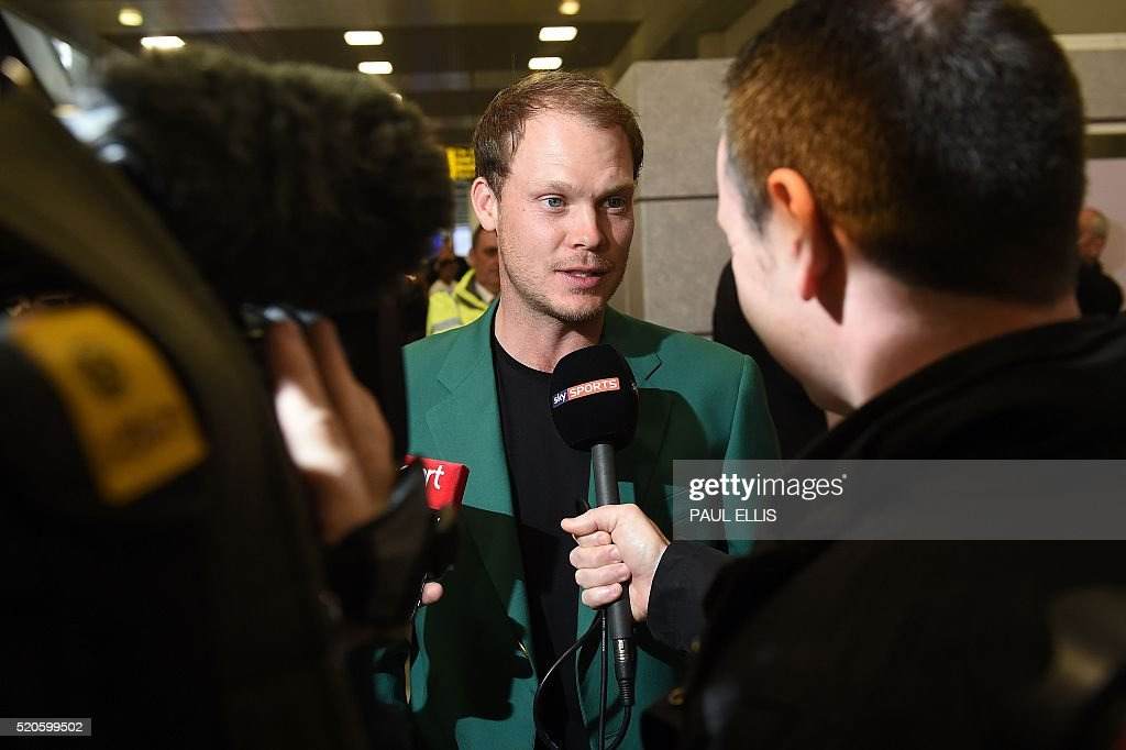 English golfer Danny Willett talks to a journalist at Manchester Airport on April 12 2016 as he returns home after winning the Masters golf...