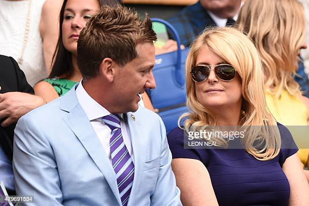 English golfer Ian Poulter and his wife Katie sit in the royal box on centre court on day seven of the 2015 Wimbledon Championships at The All...