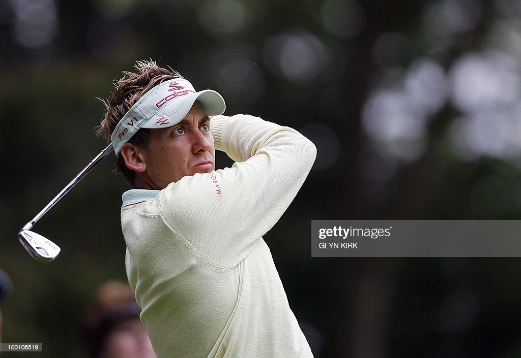 English golfer Ian Poulter watches his drive to the 2nd green on the first day of the PGA Championship on the West Course at Wentworth, central England, on May 20, 2010.