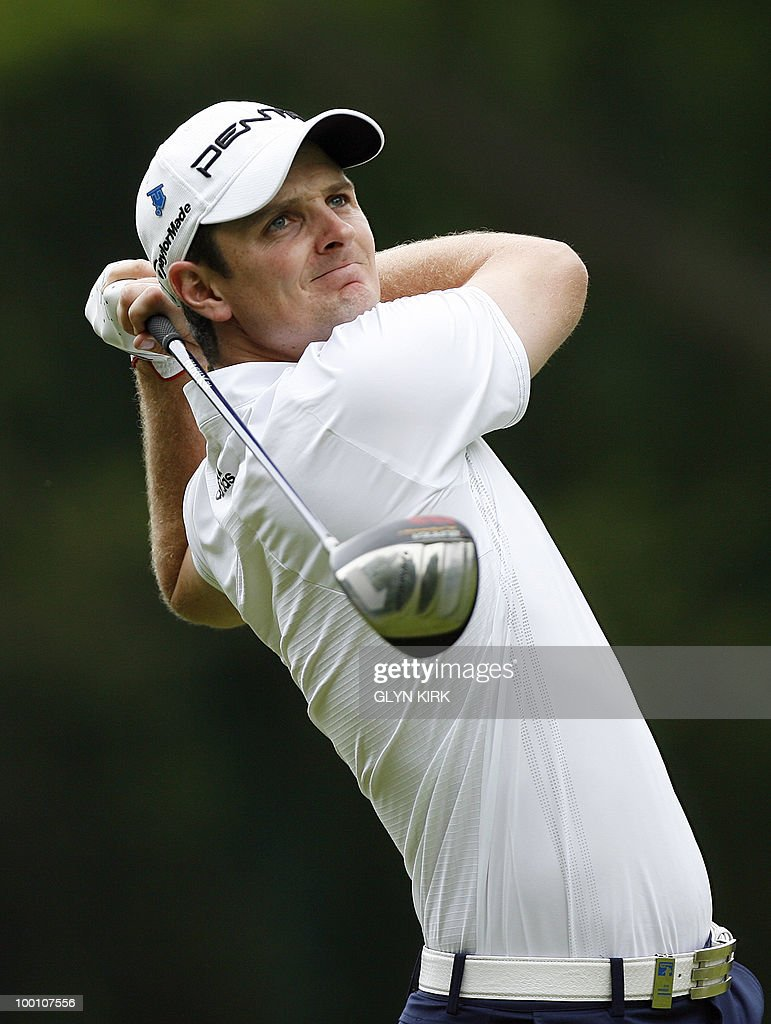 English golfer Justin Rose watches his drive from the 3rd tee during the first day of the PGA Championship on the West Course at Wentworth, England, on May 20, 2010.