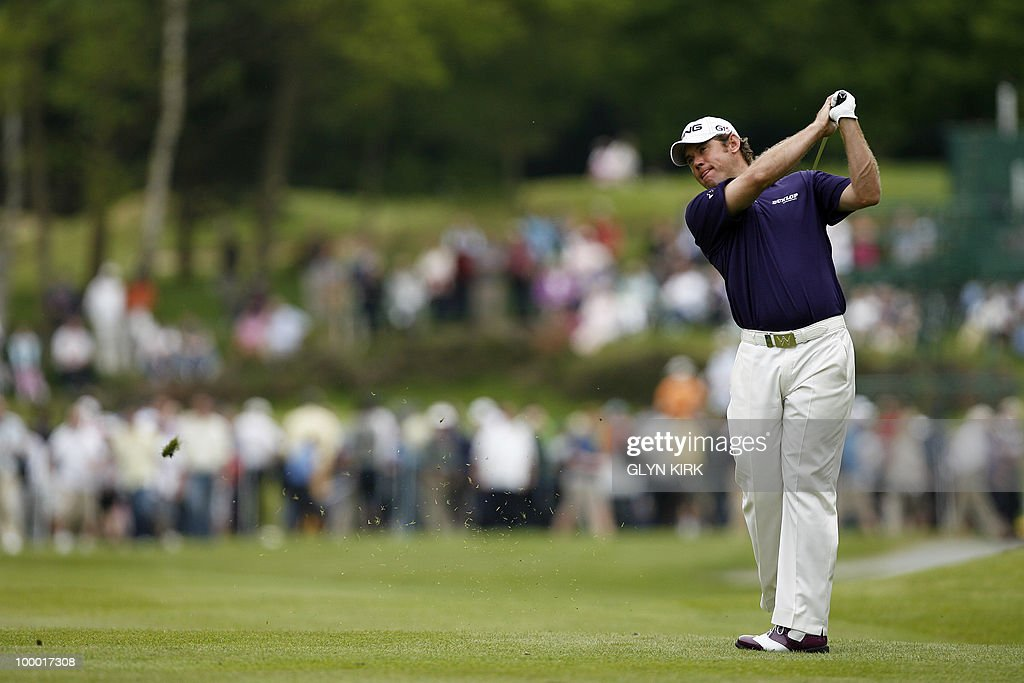 English golfer Lee Westwood watches his approach shot to the 6th green during the first day of the PGA Championship on the West Course at Wentworth, England, on May 20, 2010.