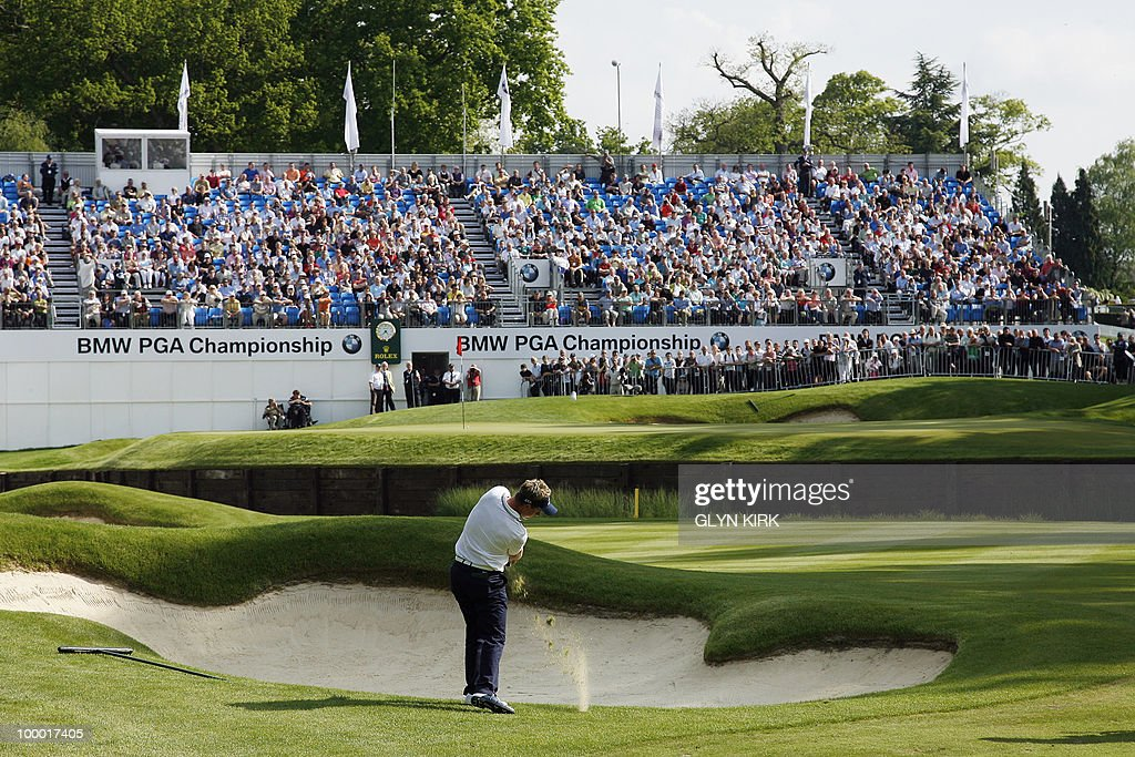 English golfer Luke Donald plays his approach shot the 18th green during the first day of the PGA Championship on the West Course at Wentworth, England, on May 20, 2010.