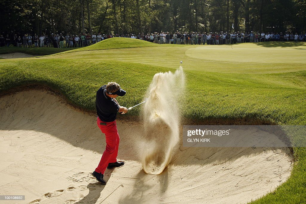 English golfer Luke Donald plays out of a bunker at the 4th green during the second day of the PGA Championship on the West Course at Wentworth, England, on May 21, 2010.