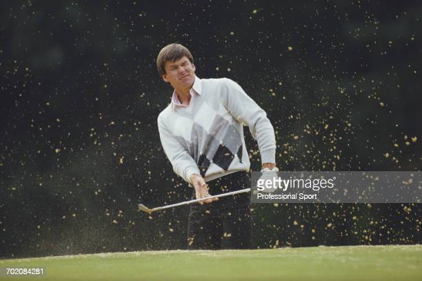 English golfer Nick Faldo pictured playing a shot out of a sand trap bunker during play in the Panasonic European Open golf tournament in England in...