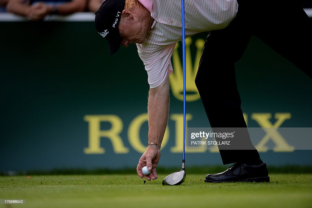 English golfer Nick Job positions the ball during the Berenberg Bank Masters Cologne European Senior Tour at the Golf and Country Club Cologne in Bergisch Gladbach near Cologne, western Germany on August 4, 2013.