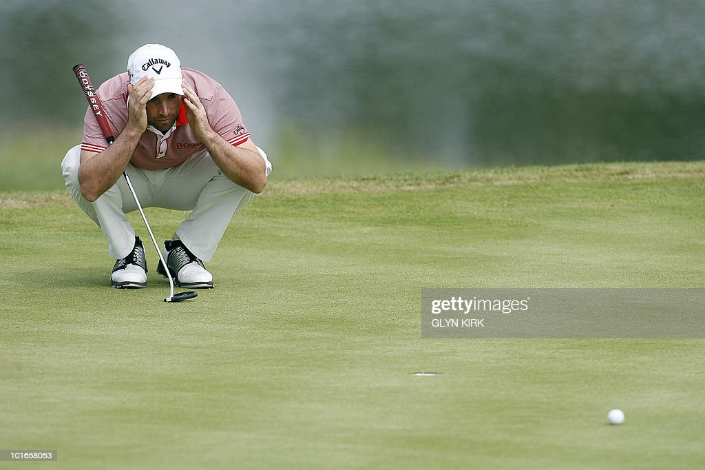English golfer Oliver Wilson lines up his putt on the 12th green during the final round of the Celtic Manor Wales Open on The Twenty Ten Course in Newport, Wales on June 6, 2010.