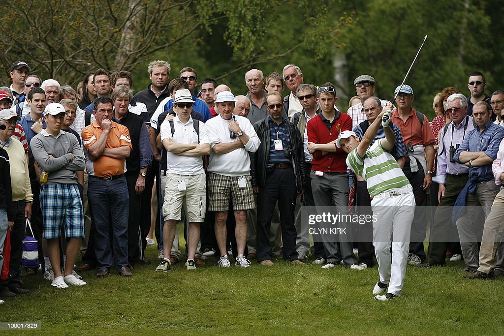 English golfer Oliver Wilson plays out of the rough by the side of the 7th fairway during the first day of the PGA Championship on the West Course at Wentworth, England, on May 20, 2010.