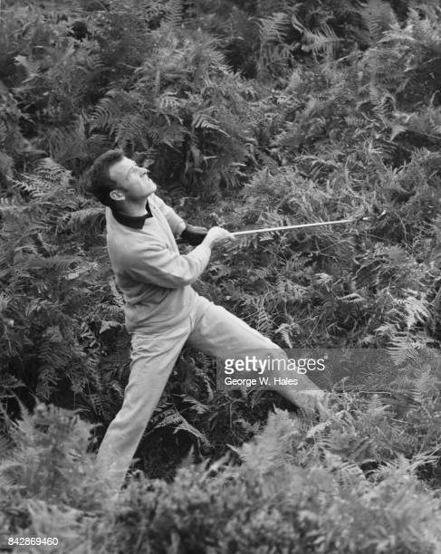 English golfer Tommy Horton of Ham Manor Golf Club drives out of the rough on the 5th hole during the News of the World Professional Golfers Match...