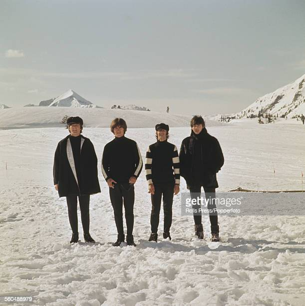 English group The Beatles posed together on a snow covered ski slope during filming of 'Help' at Obertauern in Austria in March 1965 From left to...