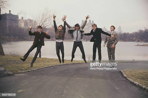 English group The Dave Clark Five leap in the air from a path in Central Park New York on 4th March 1964 From left to right Rick Huxley Denis Payton...