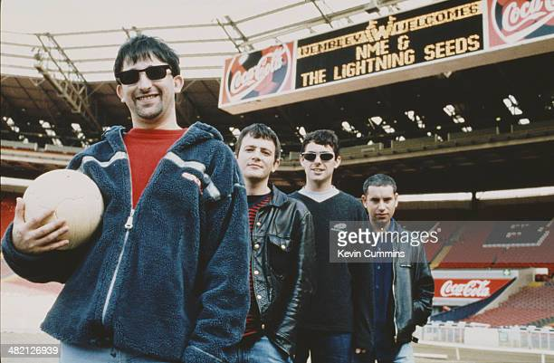 English group The Lightning Seeds at Wembley Stadium London circa 1998 Left to right singersongwriter Ian Broudie drummer Chris Sharrock bassist...